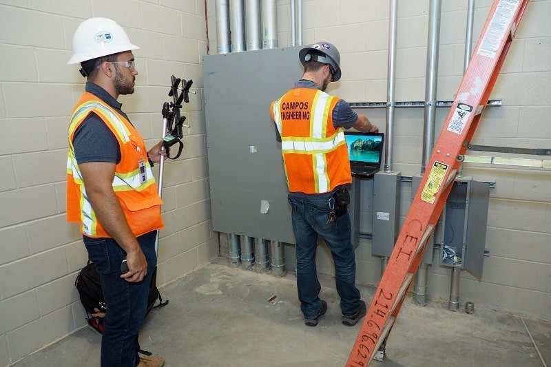 Technicians performing building diagnostic testing.